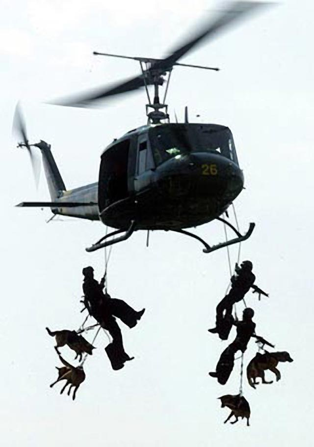 Navy Seals descending from helicopter